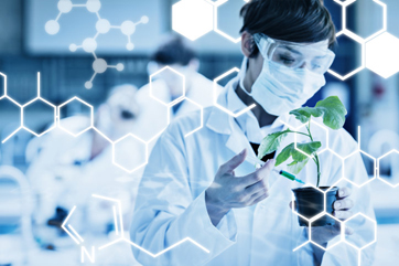 Science graphic against woman standing at the laboratory holding a plant adding chemical to soil